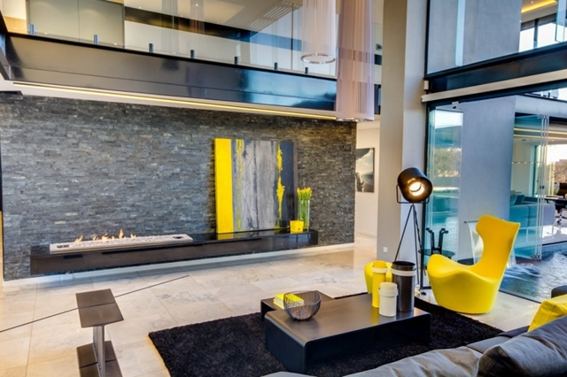 Photo of black and yellow furniture in the living room