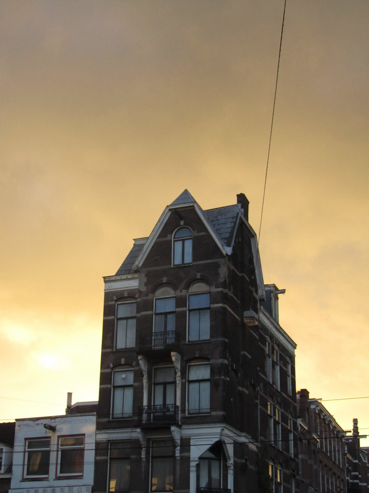 eery light with tall house and cable