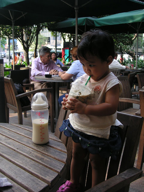 A smaller Kecil sipping coffee from the joint