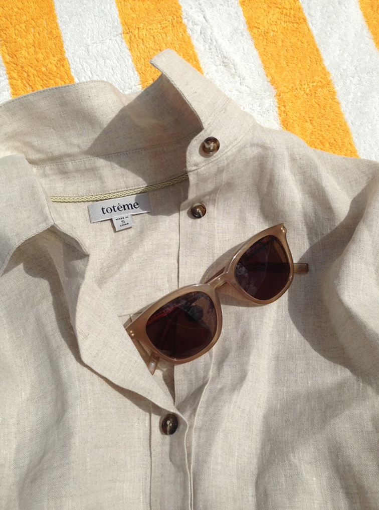 Totême raw linen shirt, Saint Laurent sunglasses, Elin Kling vacation essentials, endless summer