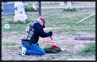 Dad placing a wreath