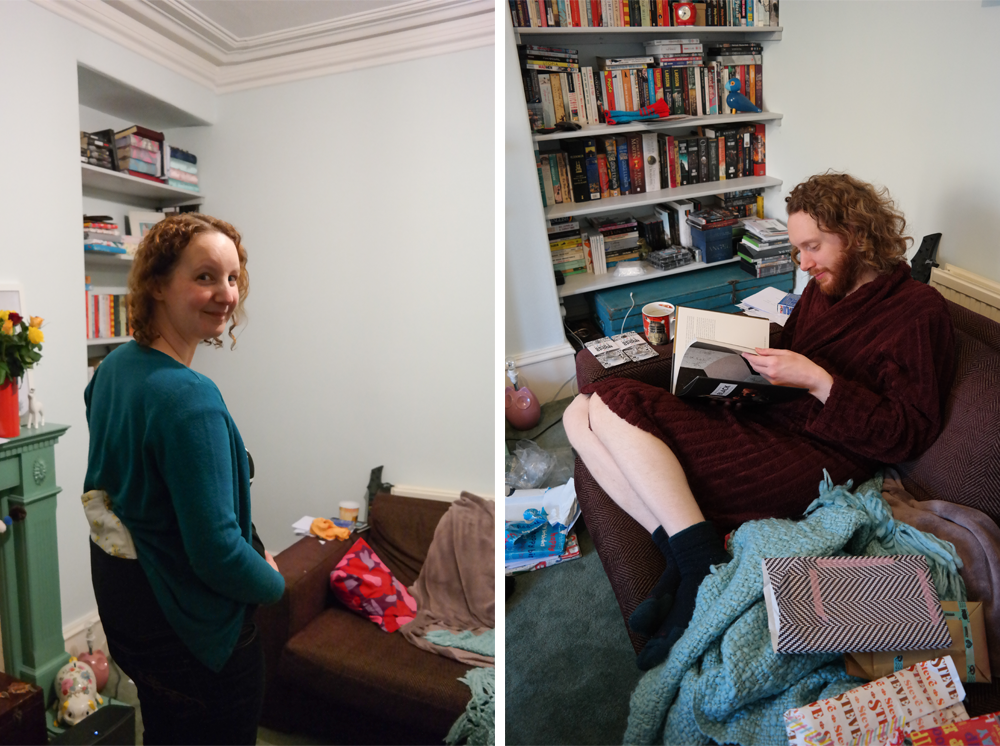 Sarah with hot water bottle shoved in maternity jeans / Steve reading a cookbook