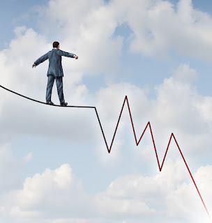 A Salesperson Trying to Find His Balance on a Tightrope of Downward Sales