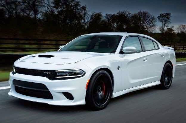 "The world is full of numbers people, those who want to qualify the concept of ""best"" with cold, hard, irrefutable performance figures. For the numbers people among us, I present the Dodge Charger Hellcat. With the Charger Hellcat's supercharged 6.2-liter Hemi V-8 producing 707 hp, 650 lb-ft of torque, a claimed 0 to 60 mph time of 3.7 seconds, a quarter-mile run of 11.0 seconds flat, and a top speed of 204 mph, Dodge says you simply can't buy a faster, more powerful production four-door sedan. Nor have you ever been able to.  Dodge isn't lying. The current crop of super sedans is the fastest yet, but none can touch the Charger Hellcat's power output or top speed. The $181,295 Porsche Panamera Turbo S has ""just"" 570 hp and will ""only"" hit 192 mph, given enough road and bravery. The BMW Alpina B7? Roughly $130,000 to start, 540 hp, 194 mph. Mercedes-Benz' $224,625 S65 AMG super sedan is electronically limited to 186 mph, despite its 621 hp. The closest top speed rival is the $207,820, 552-hp Aston Martin Rapide S with a claimed 203-mph v-max.    Of course top speed claims are really just bragging rights -- no one in the market for a four-door sedan is really running near double-century speeds -- but they're bragging rights nonetheless. Besides bar boasts, the $64,990 base price you'll plunk down for a Charger Hellcat ($4,000 more than its Challenger sibling) will actually get you a pretty special car. Sure, there's a lot of novelty factor to the Hellcat -- many will be sold on the boasts alone -- but it's surprisingly drivable on real roads in real conditions. In fact, when I was invited to drive one on the strictly speed-enforced, 55-mph roads of West Virginia recently (in the pouring rain, I might add), the Charger Hellcat was perfectly docile.   In fact, SRT vehicle dynamics chief Erich Heuschele told me a good amount of time was spent making sure the overall refinement of the Charger Hellcat was greater than that of the Challenger. To that end, the Charger version gets a bit more sound insulation than the Challenger does while also receiving slightly softer suspension tuning, thinner 32mm front/28mm rear hollow anti-roll bars, and active valves in the exhaust system that shut earlier to avoid freeway drone. Like in the Challenger Hellcat, the car comes with two keys: a red one that gives the full 707 hp and a black one that puts a cap at 500 hp when you loan your car to your idiot friend. That means the Charger Hellcat has a real Dr. Jekyll/Mr. Hyde split personality.   With the excellent new eight-speed TorqueFlite automatic transmission in ""D"" and the suspension and engine calibration in their Comfort settings, the Hellcat trundles around town with ease. On light throttle, the Hemi's V-8 burble is mellow and non-intrusive and shifting is handled quickly but with utter smoothness. Make no mistake, if temptation drives your throttle foot to the floor, all 707 horses are available in an instant, along with the manic roar that accompanies them. Cycle through Dodge's Performance Pages settings on the UConnect display, put the engine, transmission, and suspension in Sport mode, and the car comes to life, giving instant throttle response and 160ms paddle shifts, though the transmission is predictive enough that you won't often need to use them.  2015 Dodge Charger SRT Hellcat Front Three Quarter View In Motion 11 © Provided by MotorTrend 2015 Dodge Charger SRT Hellcat Front Three Quarter View In Motion 11  The winding West Virginian roads I drove, red key in pocket, led me to a very wet Summit Point Raceway, where a few laps in the rain showed not only how quickly the Hellcat's tail can swing wide with too much throttle on corner exit but also how quickly the stability control can rein in a yahoo driver with 707 horses to play with. Nevertheless, the Hellcat did a superb job of hustling around the small road course given the less-than-favorable conditions, and the Brembo brakes (six pistons in the front, four in the rear, two-piece rotors) did an admirable job, along with the three-season Pirelli P Zero tires, in hauling the car down from triple digits on the main straight. You can love or hate the Charger's new styling (Dodge says the body stampings are all-new given how much has changed), but the new Dart-esque front end and tucked-in corners do wonders to shrink the Charger visually. Much attention was given to cooling that massive Hemi engine, so triple hood scoops can be found, along with extra venting in the front fascia. Overall, the Hellcat does appear as a bit of a sleeper, considering its capability.  From behind the wheel the Charger is clearly still a full-size sedan (it's tough to hide 4,600 pounds of curb weight), but behind the wheel is a nicer place to be, aesthetically. The contrasting black and red SRT-embossed upholstery and thin strips of real aluminum trim around the instrument panel and shift bezel are nice touches, but they might not quite be enough to rationalize the purchase of a Hellcat to your significant other. Should you be tempted to try anyway, the Dodge Charger Hellcat hits showrooms this spring."