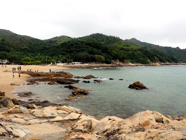 View of rocks, sand and the sea at Hung Shing Yeh beach, Lamma Island, Hong Kong