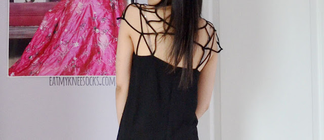 Back view of the caged cutout neckline on Romwe's original-design shift dress.