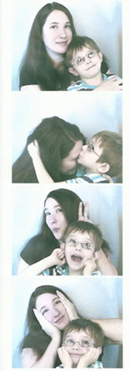 take silly pictures in a photo booth together