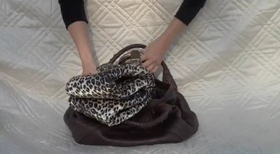 inserting fabric ring into purse