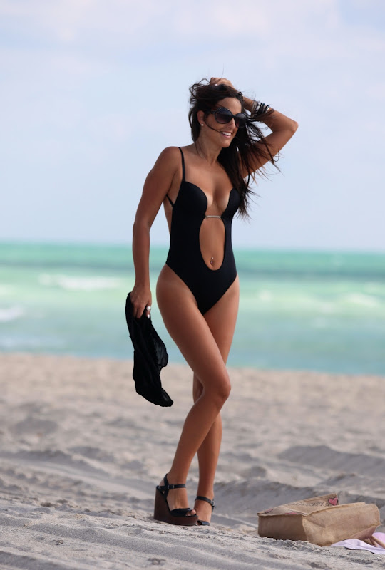 Claudia Romani wearing a super sexy black swimsuit