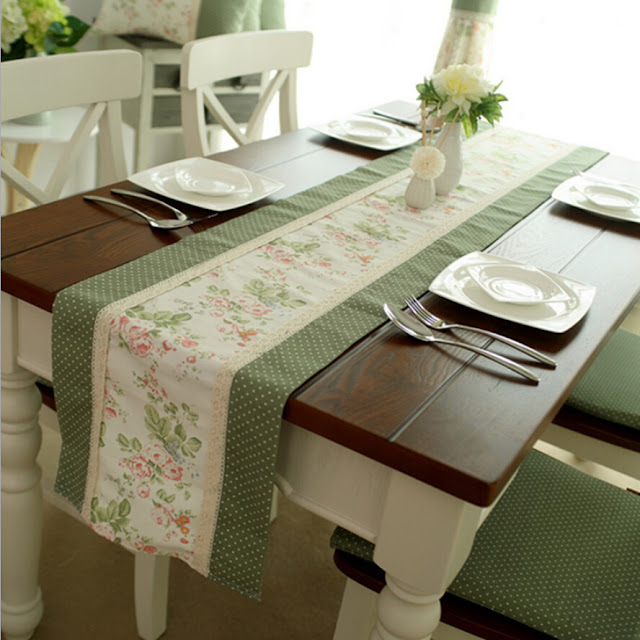 a long white coffee table runner on square wooden table with floral pattern in the middle