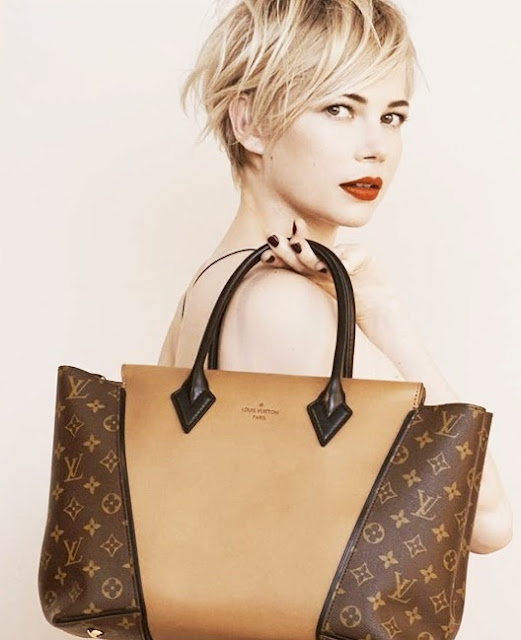 Michelle Williams holding the Louis Vuitton W Bag