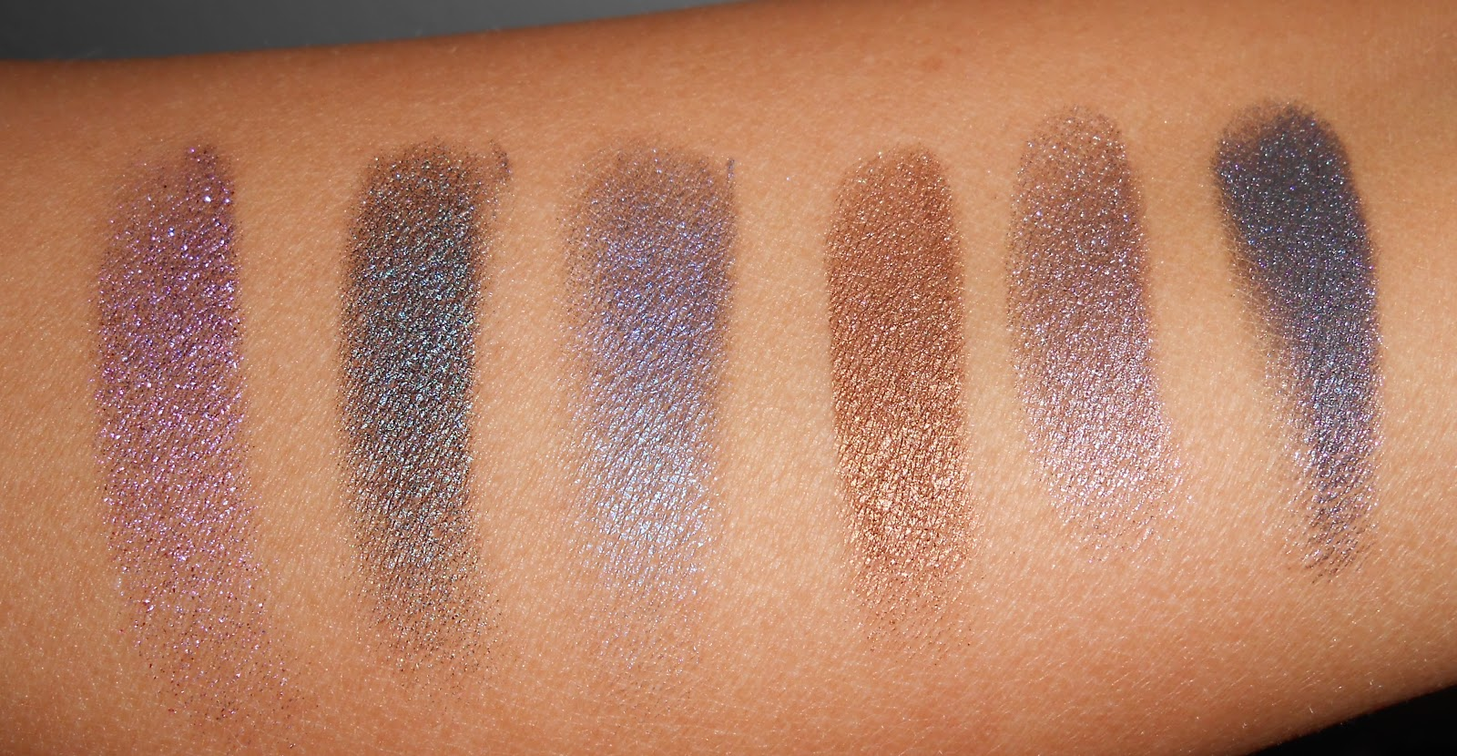 Ace is a charcoal shade but looks almost like a really deep teal when