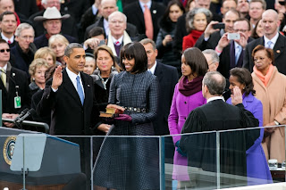 Obama family swearing in. Photo via Official White House images