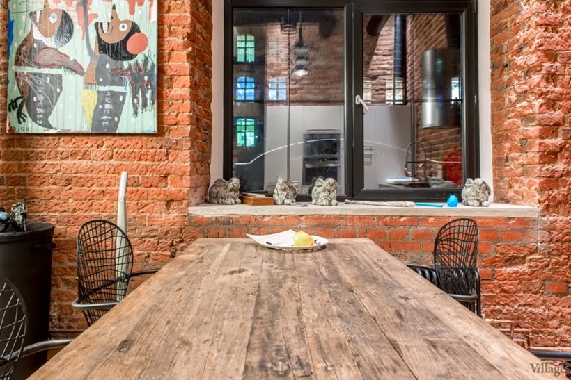 Dining table in Industrial interior design duplex apartment in Moscow