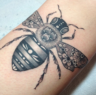black and white bee tattoo