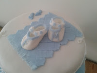 booties, christening cake