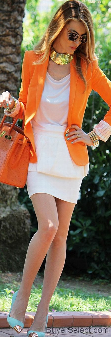 stylish outfit with orange blazer, cream dress and gold accessories