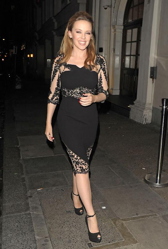 Kylie Minogue wearing a black dress