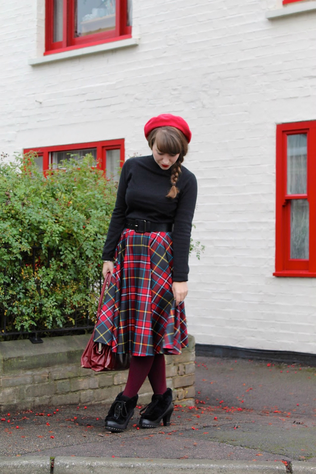 Tartan swing skirt, black polo sweater and red beret