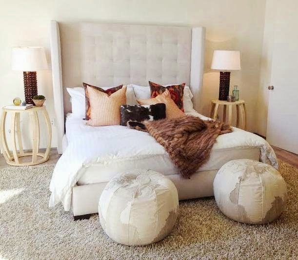 Contemporary bedroom with shag rug and poufs