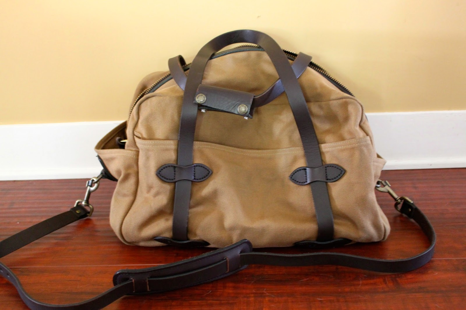 Almost New Filson Medium Travel Bag In Tan Canvas With Brown Leather Accents Used A Handful Of Times Shows No Wear Except For Little Light Dirt On The