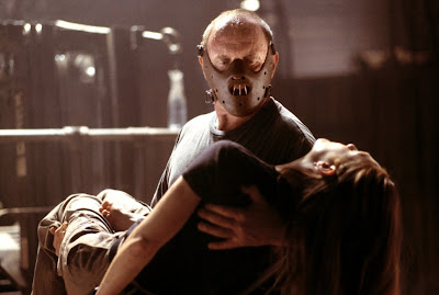 Hannibal Lecter holds the unconscious Clarice Starling in his arms, wearing the infamous Lecter mask, Hannibal, Directed by Ridley Scott