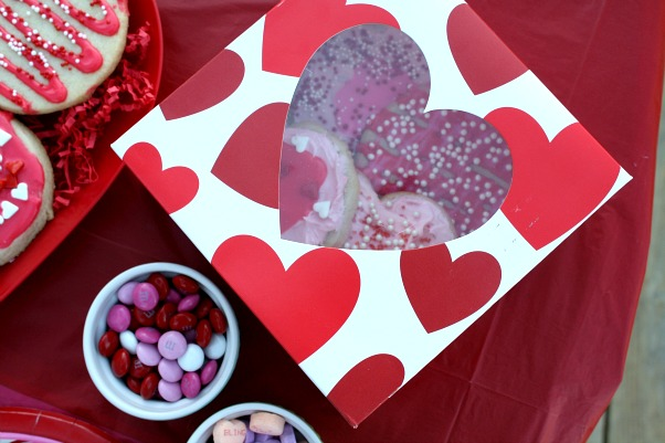once the cookies are dry let the kids package up their decorated cookies to take home - Decorated Valentine Cookies