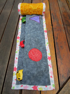 kids table runner reverse. shaped applique and toy cars in pockets.