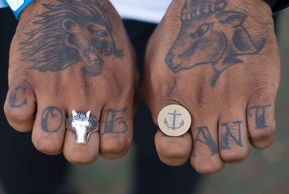 Tattoos on hand and fingers with cool rings