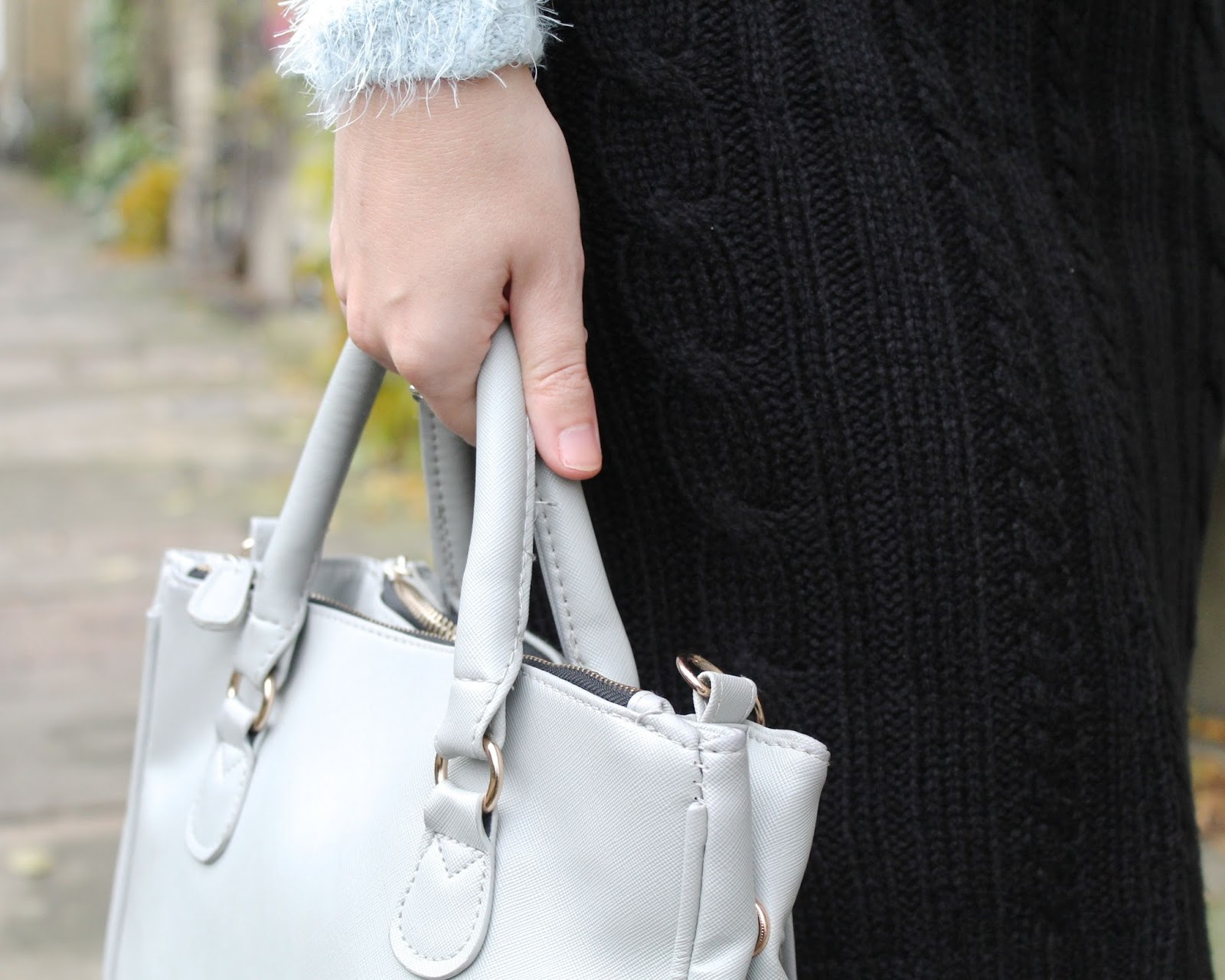 Light grey Primark handbag and black cable skirt