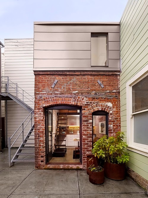 06-Brick-House-Front-View-Christi-Azevedo-Brick-House-Micro-Architecture-Laundry-Boiler-Room-www-designstack-co