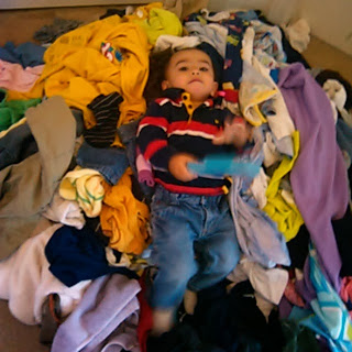 Baby in a pile of laundry