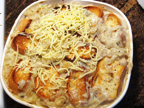 Push bread slices under the sauce and top with the remaining cheese.
