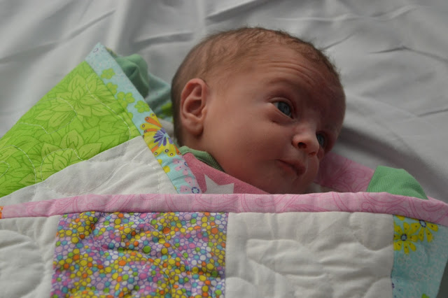 Baby wrapped up in the Girls Quilt
