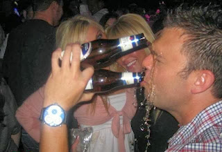 funny picture: man drinks two beers at a time