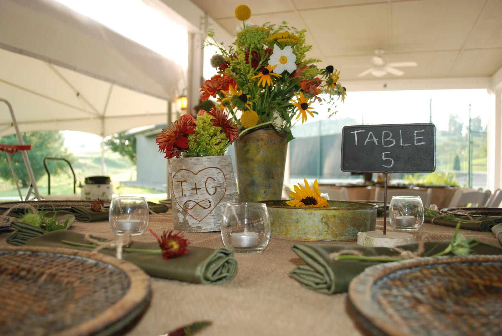Campy wedding style rehearsal dinner flowers and decor