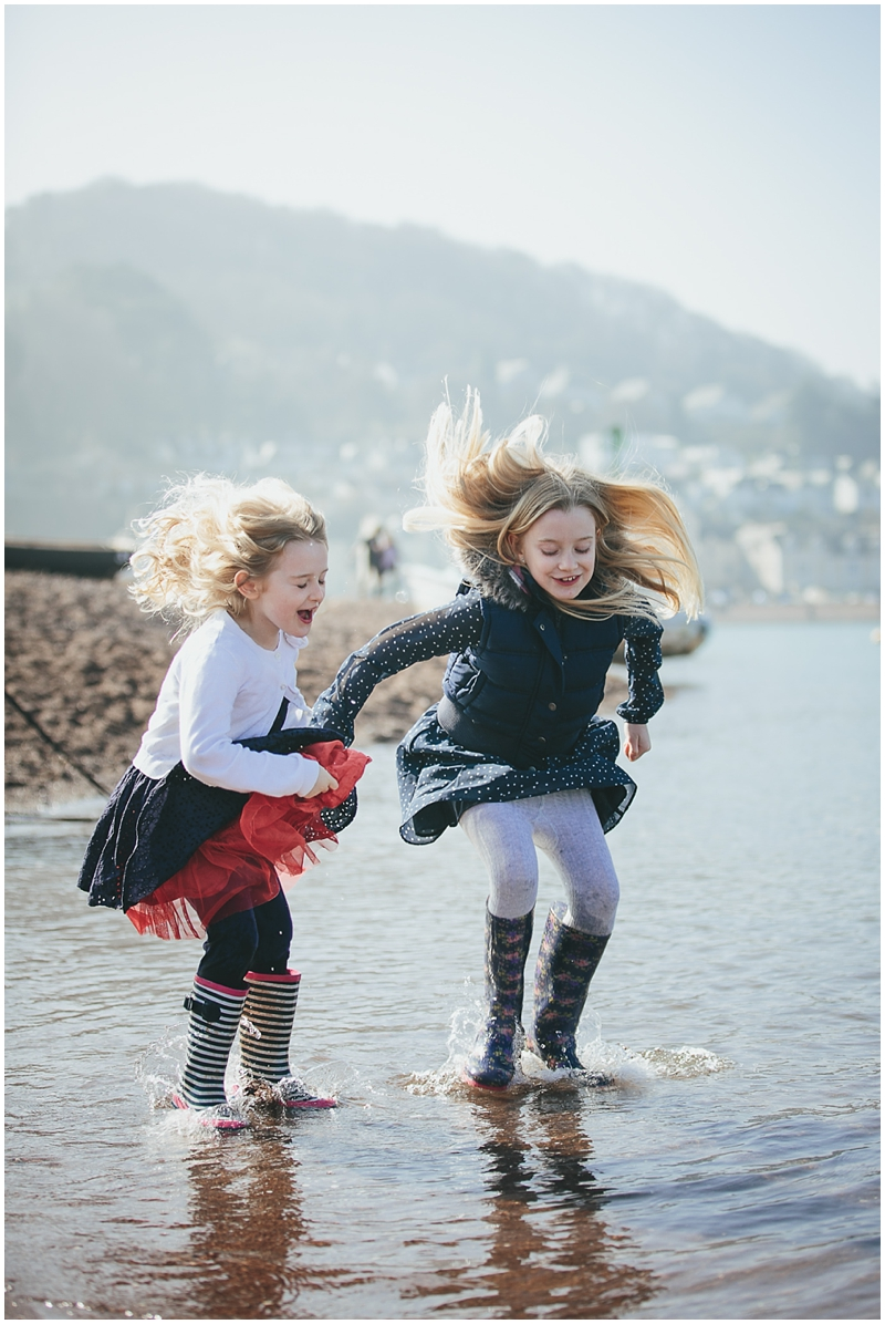Two sisters splashing in the sea