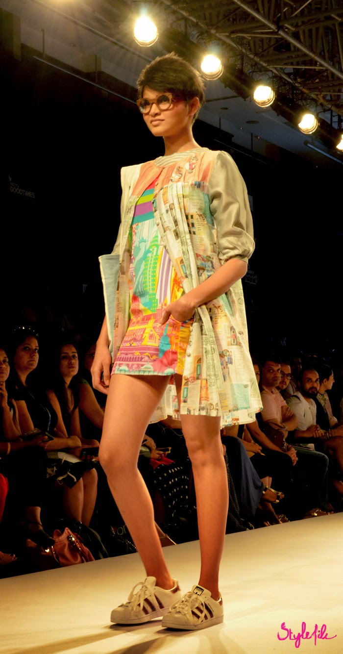 Model showcases printed dress and jacket cape of Quirkbox by designers Jayesh Sachdev and Rixi Bhatia with Adidas Originals sneakers at Lakme Fashion Week Summer Resort 2015 in Mumbai