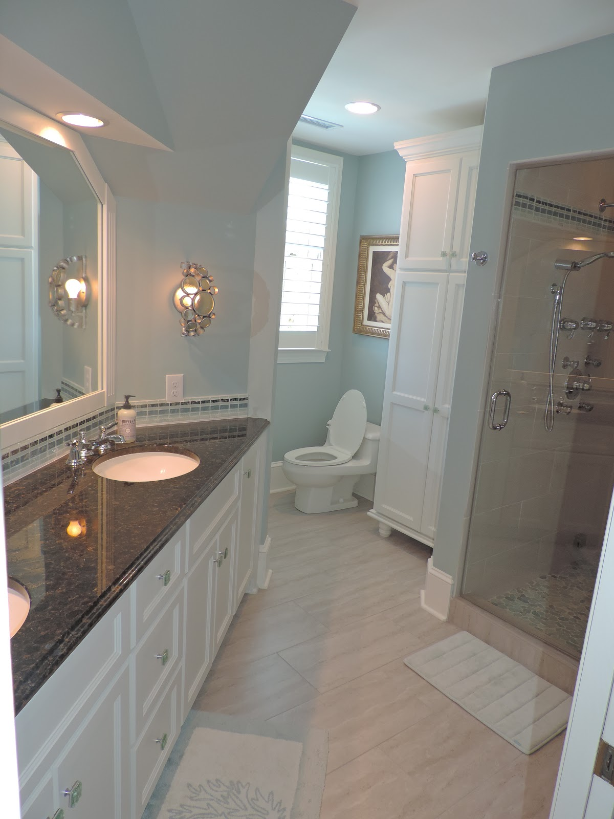 This master bath was plagued with strange angles, mauve floral