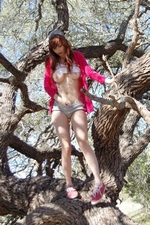 Ivy Snow climbs a tree and plays with her pussy