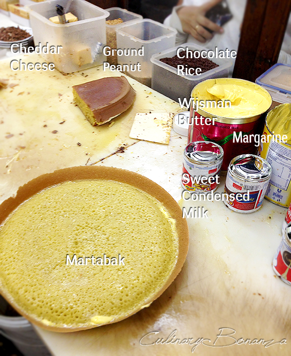 The standard ingredients in each martabak: chocolate rice, sweet condensed milk, cheddar cheese, ground peanut, margarine, wijsman butter, etc