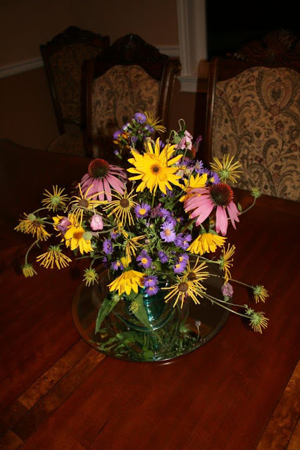 Purple / yellow garden flower arrangement