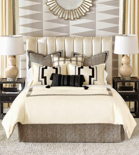 neutral master bedroom with showcase wall in geometric pattern