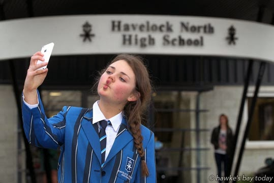Libby Rainger, year 13, Havelock North High School, Havelock North, part of a student initiative which has asked celebrities to upload selfies of themselves onto a Facebook page promoting the Havelock North Spring Fair, a fundraiser. photograph