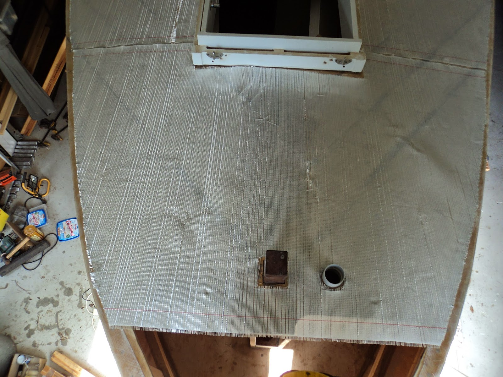 glass cloth i used for the hull and cut pieces to go across the front deck below is standing in the anchor well looking down at the very front deck
