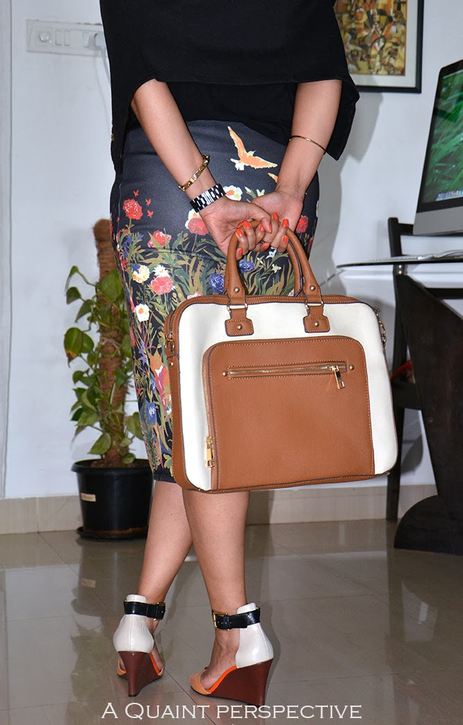 Sudipta's choice of accessories, the laptop bag, the shoes complement and gold bracelet
