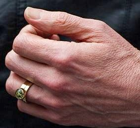 Possibly That Is His Own Ring Lower Down The Finger And Above It A Second One With An Interesting Design Emblem Could This Be Compromise