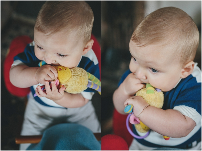 A baby chewing his toy