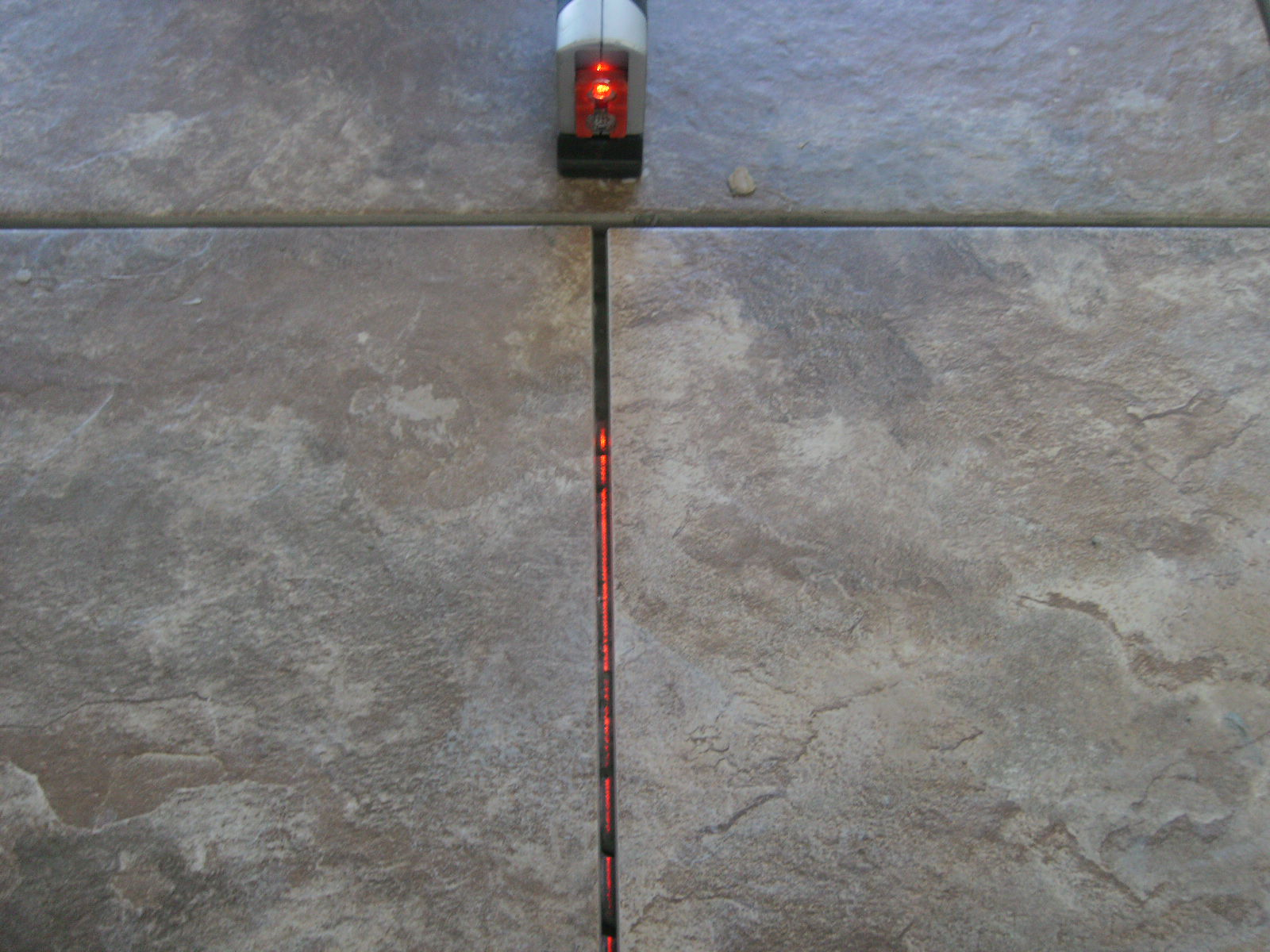 Porcelain tile install laser confessions of a tile setter this works well if you are working by yourself dont have help or a chalk line to pop lines to tile from generally i will find the longest and straightest solutioingenieria Image collections