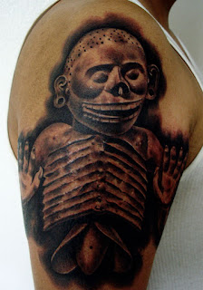 aztec tattoo covering the shoulder and the arm: Mictlantecuhtli, the lord of Mictlan
